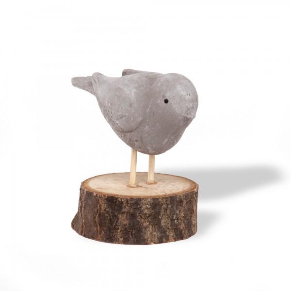 Vogel auf Holzständer